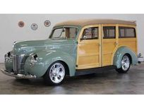 1940 ford deluxe station wagon https://cloud.leparking.fr/2020/06/26/00/28/ford-de-luxe-1940-ford-deluxe-station-wagon-green_7654586651.jpg