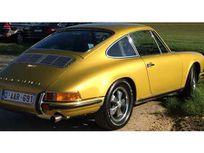 porsche 911 911t https://cloud.leparking.fr/2020/12/31/00/42/porsche-911-classic-porsche-911-911t-jaune_7918515807.jpg