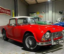 1963 TRIUMPH TR4 WITH SURREY TOP AND WIRE WHEELS, SIGNAL RED
