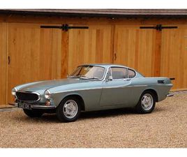 VOLVO P1800E, 1971. BLUE METALLIC WITH BLACK LEATHER INTERIOR. 4 SPEED WITH OVERDRIVE.