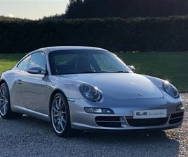 997 CARRERA S 3.8 6 SPEED MANUAL. ARCTIC SILVER METALLIC WITH BLACK LEATHER. SOLD.