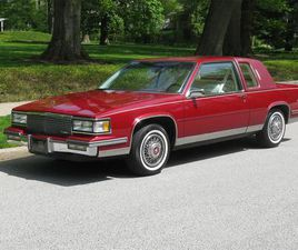 FOR SALE AT AUCTION: 1987 CADILLAC DEVILLE IN CARLISLE, PENNSYLVANIA