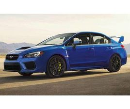 STI LIMITED WITH LIP SPOILER MANUAL