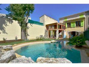 Vente maison (piscine  cuisine aménagée  en pierre  balcon  véranda  stationnement) Fontvi