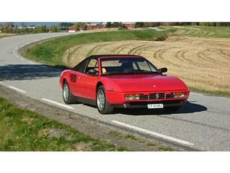 https://cloud.leparking.fr/2020/06/22/22/02/ferrari-mondial-cabriolet-rouge_7650356111.jpg --